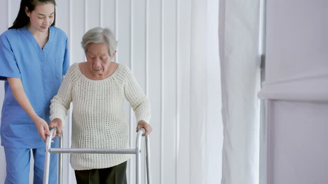 asian female nurse doctor helping asian senior women age 82 yearold walk training and rehabilitation process at home or hospital.elderly grandmother listen caregiver giving support,older people healthcare,physical therapy.at home caregiver - care stock videos & royalty-free footage