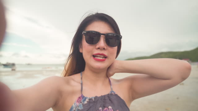 asian female photographer aged 20-30 years  using digital camera take photography while traveling by sea in thailand,new normal office lifestyle after coronavirus lockdown and travel reopen, - live broadcast stock videos & royalty-free footage