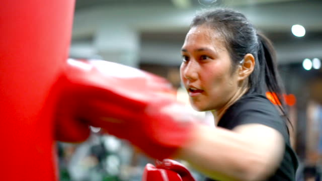 slo mo asian female practicing muay thai in gym. - mitten stock videos and b-roll footage