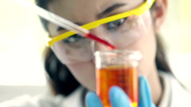 asian female scientist mixing chemical liquid in lab - diesel fuel stock videos and b-roll footage