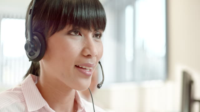 tu asian female tech support operator talking to customer - headset stock videos & royalty-free footage