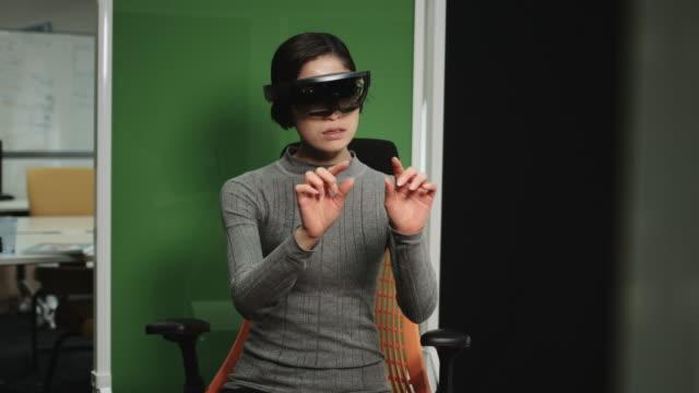Asian female Using Virtual Reality