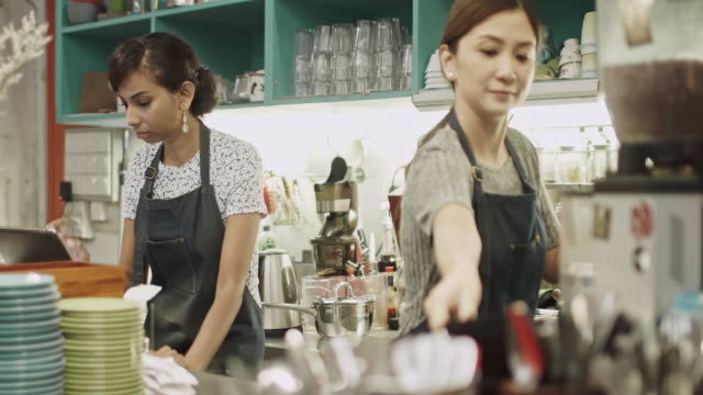 Asian female working at coffee Shop in Kuala Lumpur