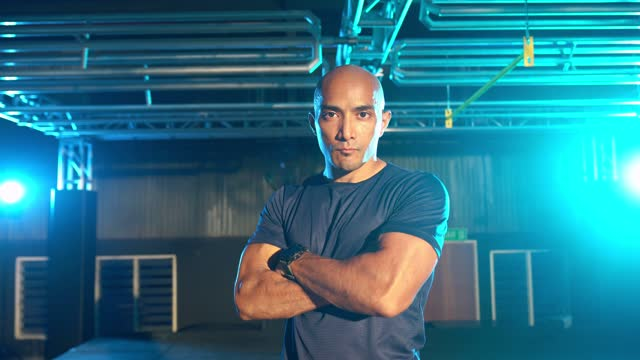 asian fitness instructor portrait looking at camera with cool attitude arm crossed - military training stock videos & royalty-free footage