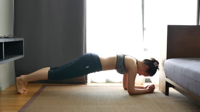 asian fitness woman planking exercise at home - plank stock videos & royalty-free footage