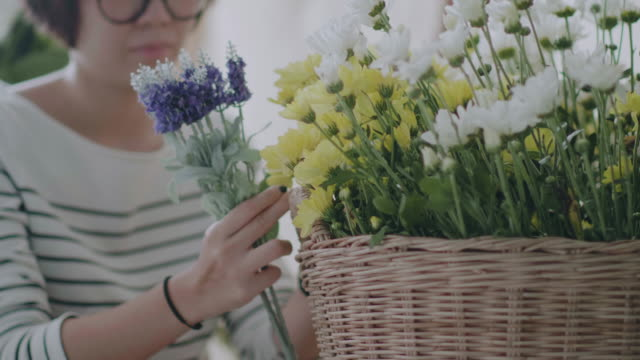 asian florists arranging bouquets in flower shop - florist stock videos and b-roll footage