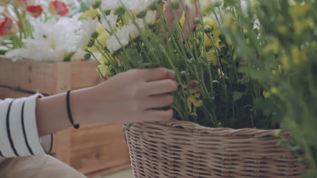 asian florists arranging bouquets in flower shop - flower shop stock videos and b-roll footage