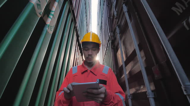 asian foremen walking while using digital tablet control industrial loading containers box from cargo freight ship for import export.technology,delivery,commerce,growth,connection,communication,business,industry,warehouse concept - equipment stock videos & royalty-free footage