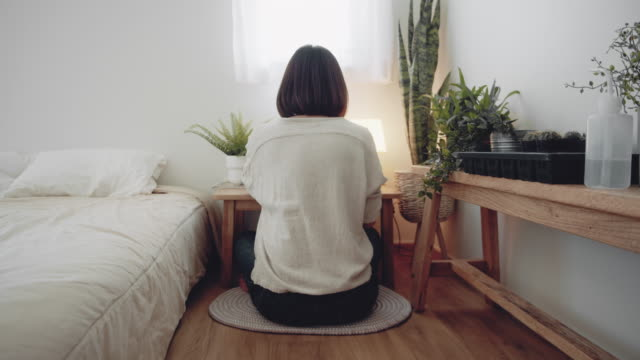 asian freelancer woman using laptop in home garden - rear view stock videos & royalty-free footage