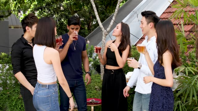 vídeos de stock e filmes b-roll de asian friends enjoying drinks and food at rooftop party - malaysian culture