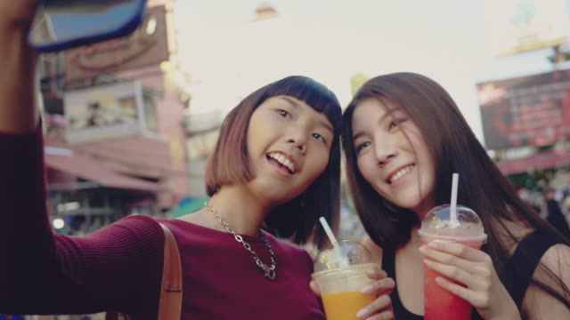 asian friends take a photo of trendy drink - smoothie stock videos & royalty-free footage