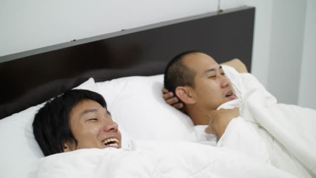 asian gay couple homosexual couple on bed - condom stock videos and b-roll footage