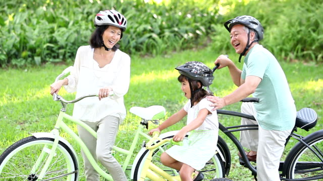 asian girl and grandparents riding bicycles - japanese ethnicity stock videos & royalty-free footage