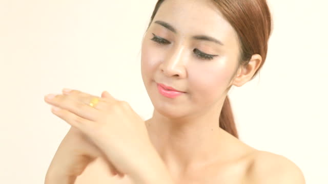 asian girl applying moisturizer