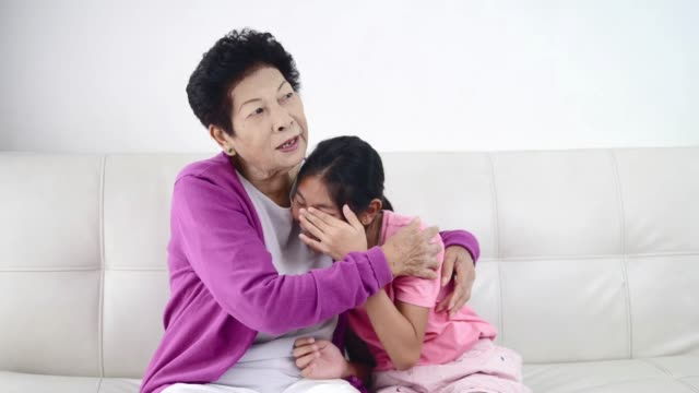 asian girl crying with her grandmother at home. - losing virginity stock videos & royalty-free footage