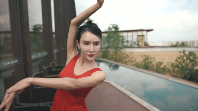 asian girl dancing in red dress on the open ground - red dress stock videos & royalty-free footage