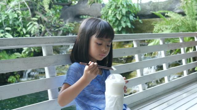 Asian girl drink milk shake in coffee shop