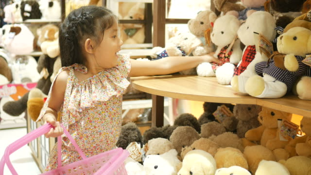 asian girl having fun shopping toy - teddy bear stock videos and b-roll footage