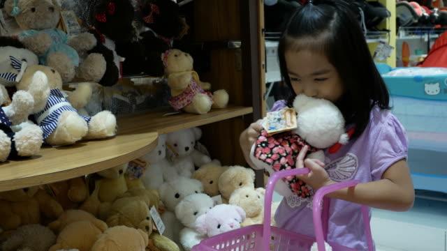 Asian girl having fun shopping toy