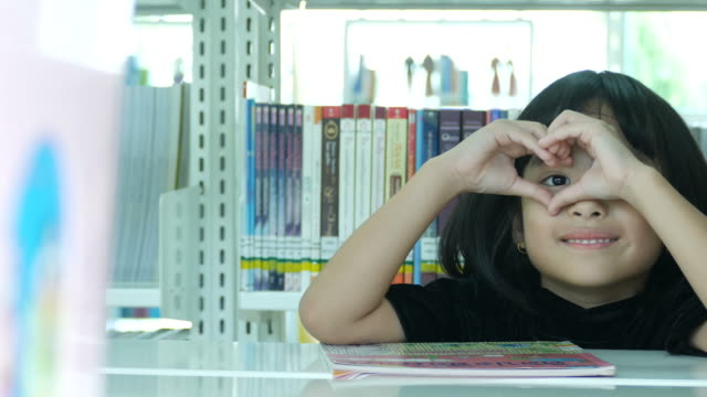 asian girl in library , heart sign - primary school child stock videos and b-roll footage
