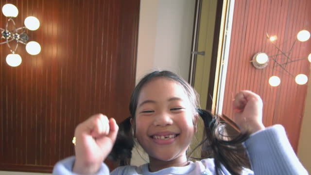 asian girl opening cardboard box and looking inside,is surprised and happy,slow motion - offspring stock videos & royalty-free footage