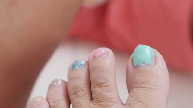 asian girl painting toenails polish for her mother at home, lifestyle concept. - painting toenails stock videos & royalty-free footage