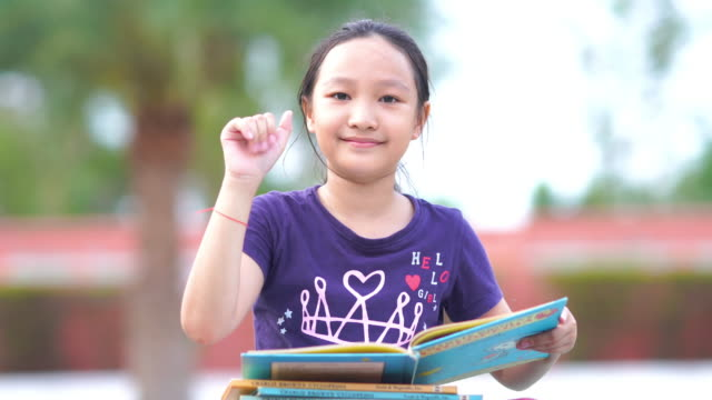 asian girl reading book in garden , success , beckoning - one teenage girl only stock videos & royalty-free footage