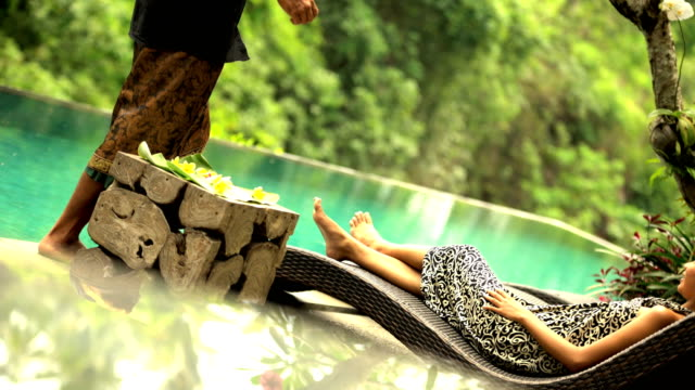 Asian girl relaxing in sarong at Balinese spa