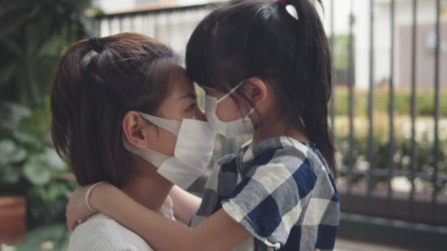 asian girl running to embrace her mother during the pandemic - prevention stock videos & royalty-free footage