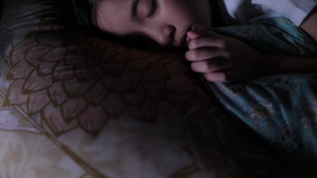 asian girl sleeping in her bedroom - sleeping stock videos & royalty-free footage