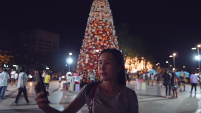 asian girl standing selfie on christmas tree. - editorial stock videos & royalty-free footage