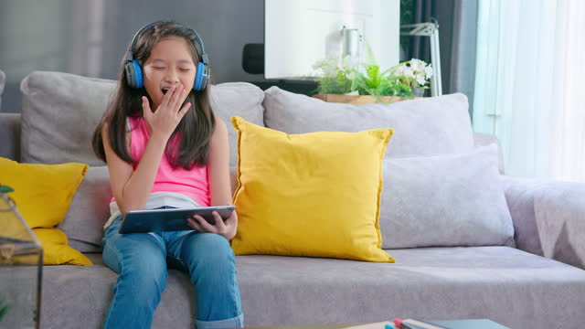 asian girl student listening online class on smart phone while  homeschooling at home. - childhood stock videos & royalty-free footage