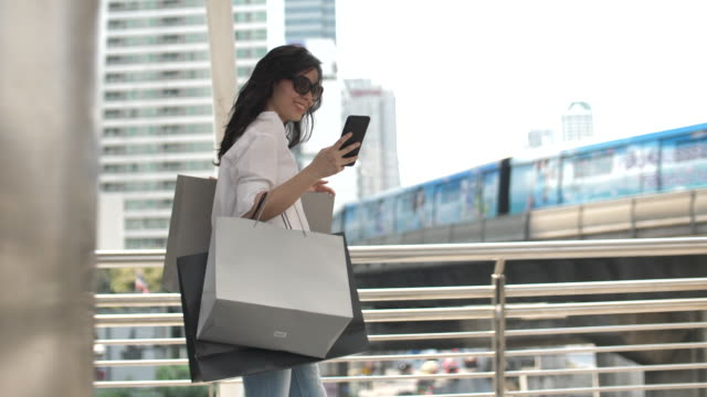 asian girl surfing the net with smartphone for shopping - bag stock videos & royalty-free footage