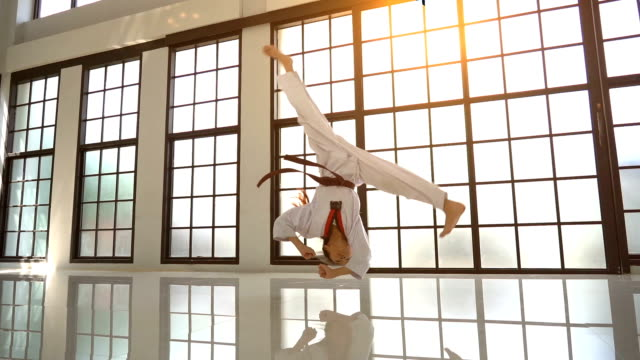 asian girl taekwondo jumping somersault - kicking stock videos & royalty-free footage