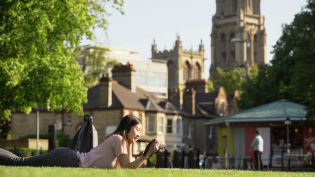 asian girl take photo - cambridge england stock videos and b-roll footage