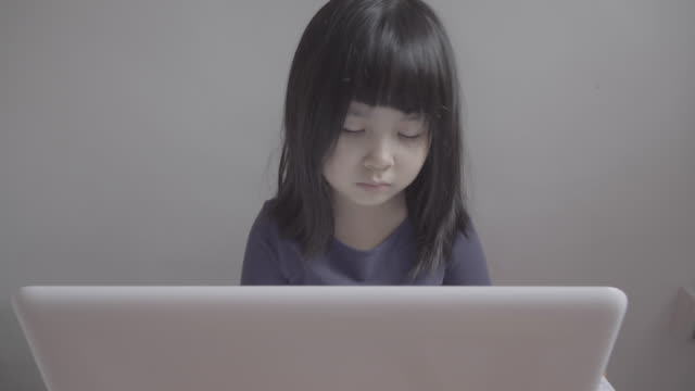 asian girl using computer at home - little girl webcam stock videos & royalty-free footage