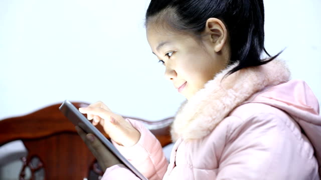 Asian girl using digital tablet