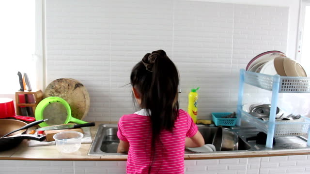 asian girl washing kitchenware - stereotypical stock videos & royalty-free footage