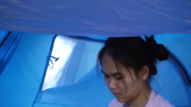 asian girls play smart phones at camping. - genderblend stock videos & royalty-free footage