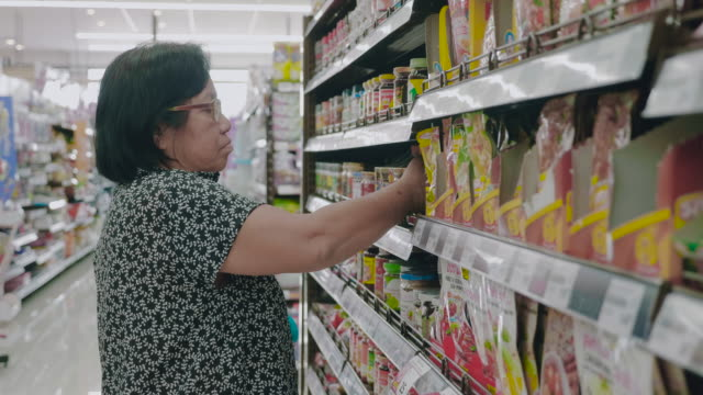 asian grandmother in grocery store - labelling stock videos & royalty-free footage