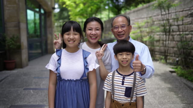 asian grandparents with their grandchildren - waving stock videos & royalty-free footage