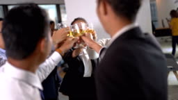 Asian group of business poeple with glasses of whiskey