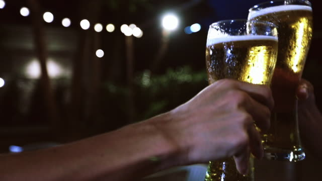 asian group of friends having party with alcoholic beer drinks and young people enjoying at a bar toasting cocktails and clinking glasses - celebratory toast stock videos & royalty-free footage