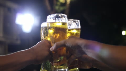 asian group of friends having party with alcoholic beer drinks and young people enjoying at a bar toasting cocktails and clinking glasses - honour stock videos & royalty-free footage