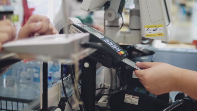 asian hipster woman in grocery store - receipt stock videos & royalty-free footage