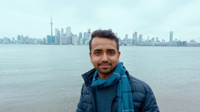 asian immigrant in canada & futuristic toronto skyline from lake ontario - emigration and immigration stock videos & royalty-free footage