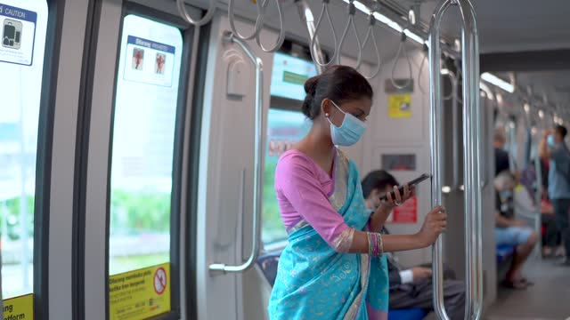 asian indian young lady wearing medical face mask in subway train - young women stock videos & royalty-free footage