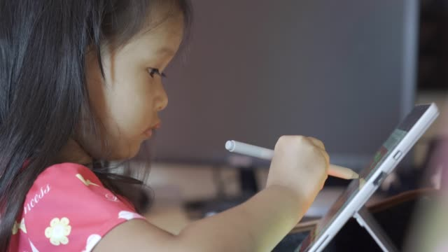 asian kid draw on the tablet - digital native stock videos & royalty-free footage