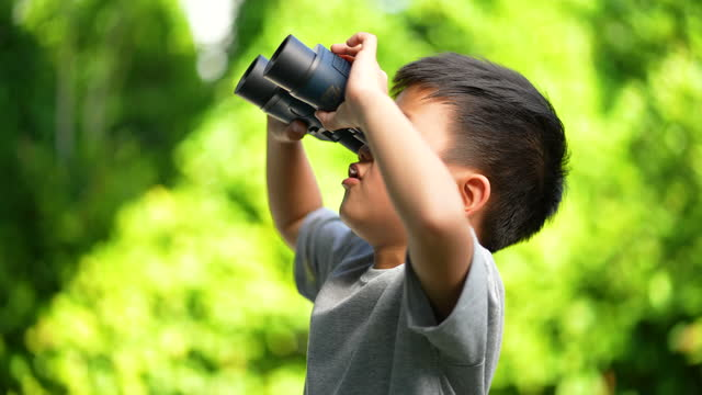 asian kid learn outdoors with binoculars. concept of learning outside - binoculars stock videos & royalty-free footage