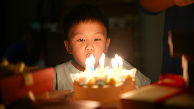 asian kid with his birthday cake. concept of celebration and joy - candle stock videos & royalty-free footage